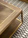 block and chisel coffee table gold frame and wood top and bottom shelf