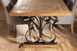 dining table with black metal base and elm wood top