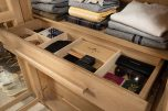 Block and chisel wardrobe drawers and shelves in brushed oak
